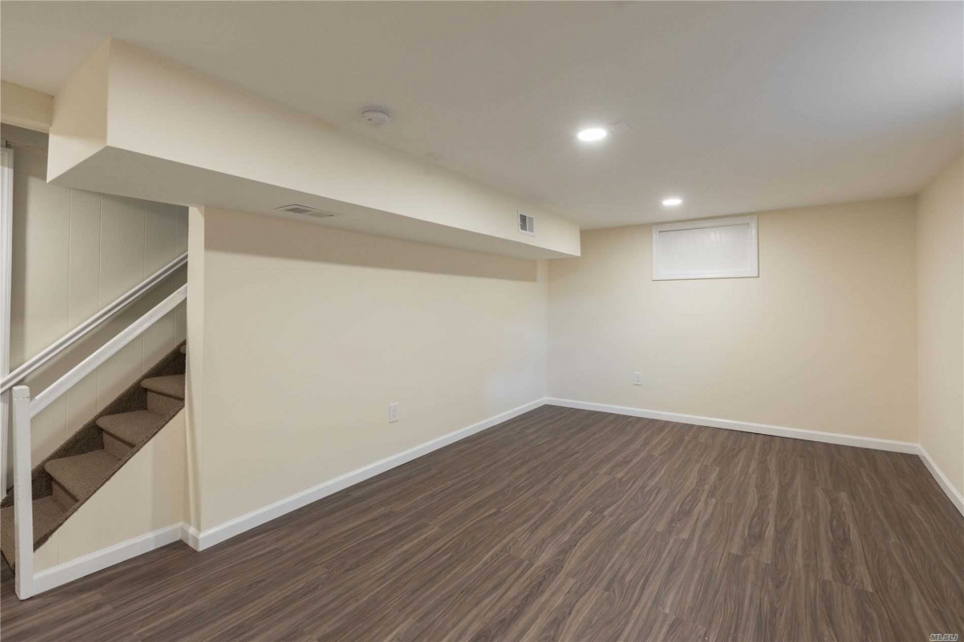 New laminate flooring in finished area of basement