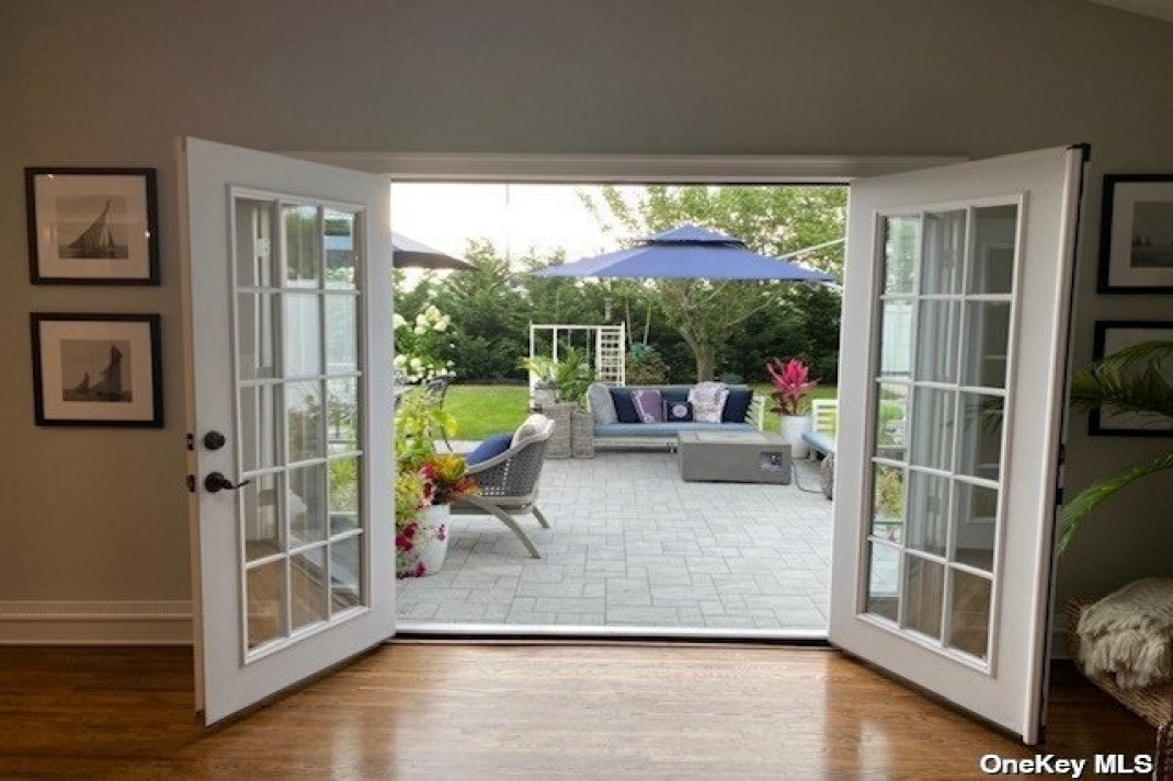den with french doors leading to large yard