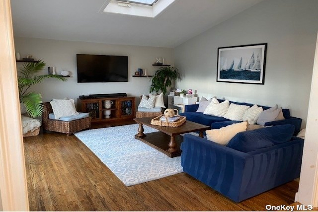 den with vaulted ceiling
